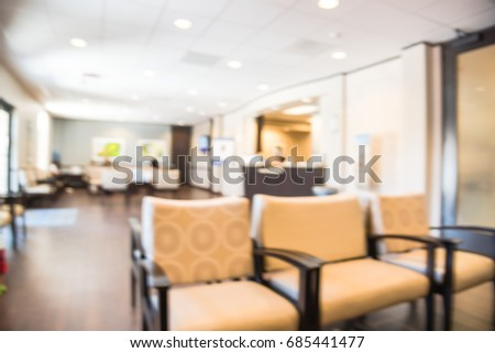 Blurred cashier counter of primary care for preventive health care and treatment of acute, chronic illnesses in Texas, US. Abstract background of patient waiting area at medical center hospital office