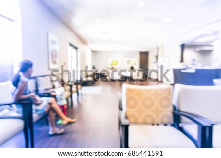 Blurred cashier counter of primary care for preventive health care and treatment of acute, chronic illnesses in Texas, US. Abstract patient waiting area at medical center hospital office. Vintage tone