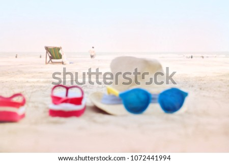 59142625084b Free photos Flip flops and sunglasses on tropical beach with waves ...