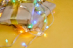 Blurred Christmas background. Defocused image for background usage. Christmas decorations and gift boxes. Gaussian blur filter applied