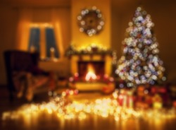 Blurred christmas background with fireplace and christmas tree