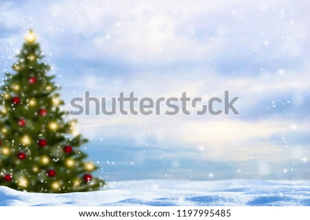 blurred christmas tree in snowy landscape #1197995485