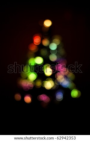 Blurred christmas tree lights isolated on black