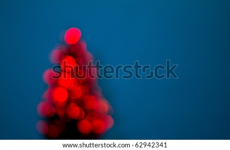 Blurred christmas tree on blue background