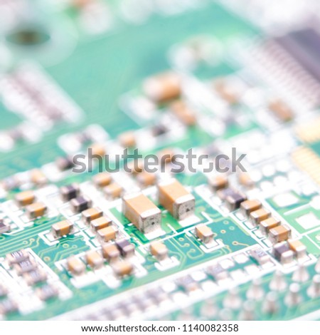 blurred circuit board in the light like concept of technology and future micro technology and computer #1140082358