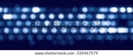 Blurred circular keyboard reflections on monitor  #320467979