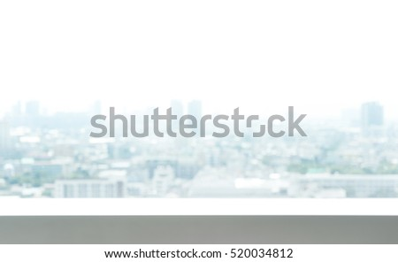 Blurred city background from window glass
