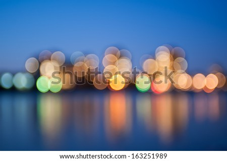 Blurred city lights with bokeh effect reflected on water.  London, UK, river Thames #163251989