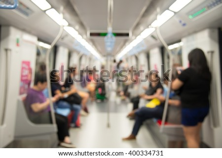Blurred city people lifestyle background, inside the train.
