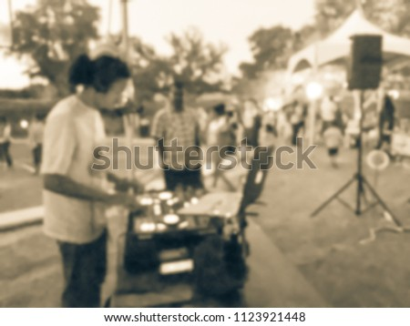 Blurred close-up of DJ mixing music on DJ performance controller with integrated laptop stand. DJ mixing track at local event in Irving, Texas, USA. Music festival and entertainment concept #1123921448
