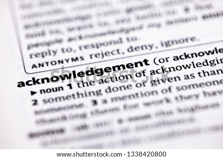 Closeup of English dictionary page with word acknowledgement  Images