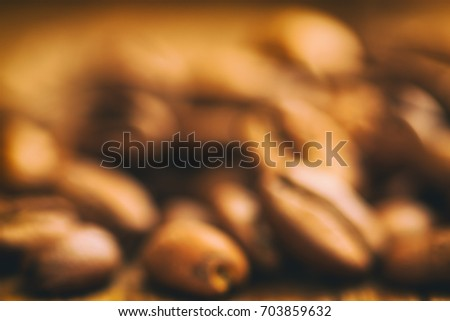 Blurred coffee beans background. #703859632