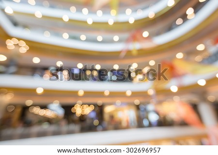 Blurred colorful interior of shopping mall with bokeh for summer sale and promotion background