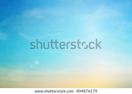 blurred colorful natural sky clouds landscape background with light.blurry sunshine wallpaper concept.backdrop pastel cool tone.blur idyllic shores sundown hour.abstract dream magic coastline dramatic