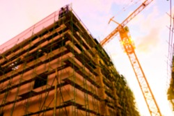 Blurred construction site build the big building with crane and steel structure at sunset
