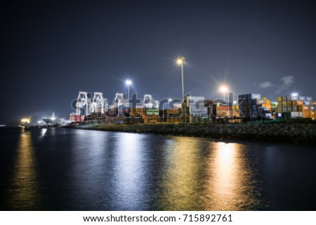 Blurred container ship in import export and business logistic,Trade Port , Shipping,cargo to harbor.Aerial view,Water transport,International,Shell Marine,transportation,logistic,by crane,At night