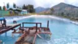 Blurred cooling pool on the geothermal power plant