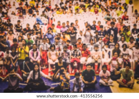 Blurred crowd of children in the hall view from top for background