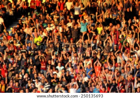 Blurred crowd of people in a stadium #250135693