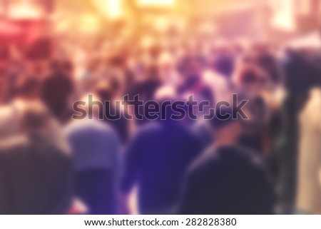 blurred crowd of people on...
