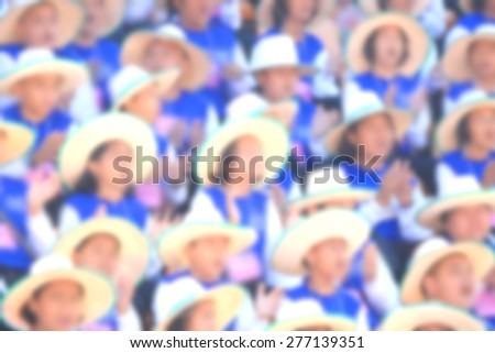 Blurred crowd of people system order in sport stadium