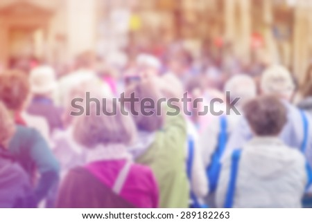 Blurred Crowd of Senior People On Street, Citizenship Concept with Unrecognizable Crowded Old Population out of Focus, Vintage Toned Image.