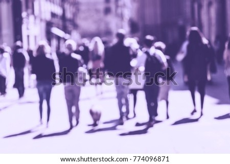Blurred crowd of walking people in the city with buildings in the background. Ultra Violet toning #774096871
