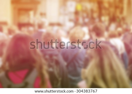 blurred crowd of young people...