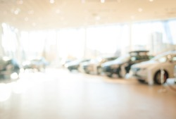 Blurred dealership store, with the cars and soft lightning