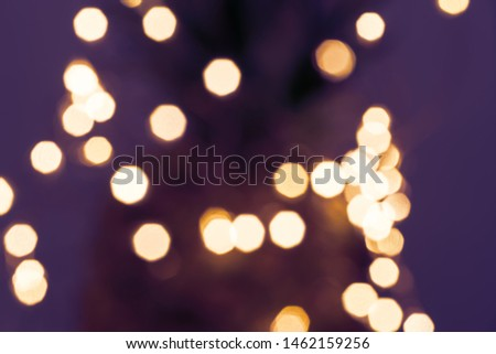 Blurred defocused fairy light glitter by Christmas lights on dark background, shallow DOF #1462159256
