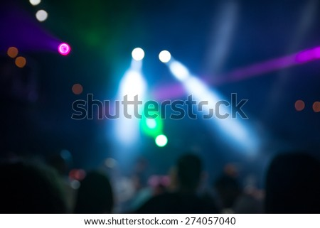 blurred disco party. defocused concept about disco night party. people dancing in the mix of music and lights