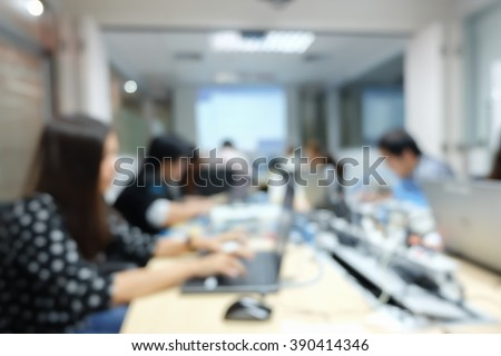 blurred employee thoughtful programming code system:blur people work research data information:blur group of smart network engineering staff focus assignment at workstation:tech communication concept #390414346