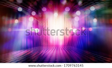 blurred empty theater stage with fun colourful spotlights, abstract image of concert lighting  illumination background ストックフォト ©