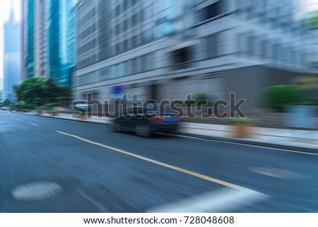 blurred empty urban road and modern buildings #728048608