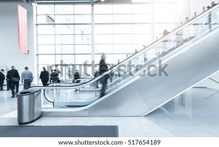 blurred Exhibition visitors at a escalator