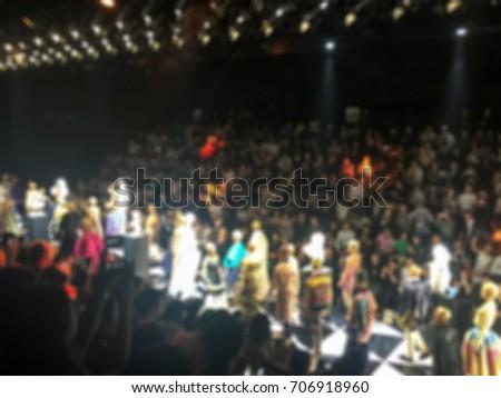 Blurred Fashion show runway , catwalk event , Spectators watching and taking photo models walk #706918960