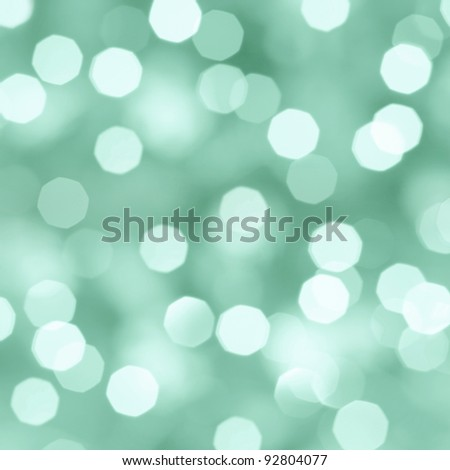 Blurred festive colorful lights over black useful as background