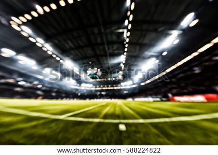 Blurred field with lights and full of spectators at the stadium one step at a sporting event #588224822