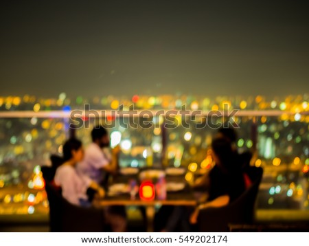Blurred focus of rooftop restaurant with people dinning at night #549202174