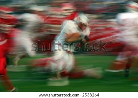 Blurred football players