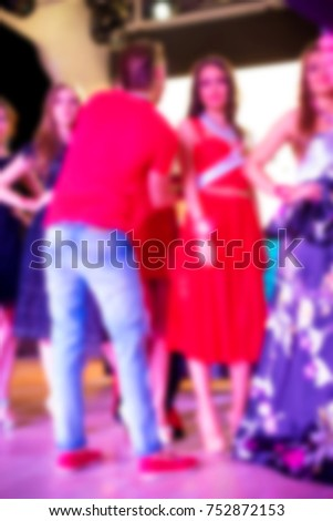 Blurred for background. Ibiza club fashion show. Nightclub show. Fashion show on stage with many in audience. Large crowd of people having fun in a nightclub during the show. #752872153