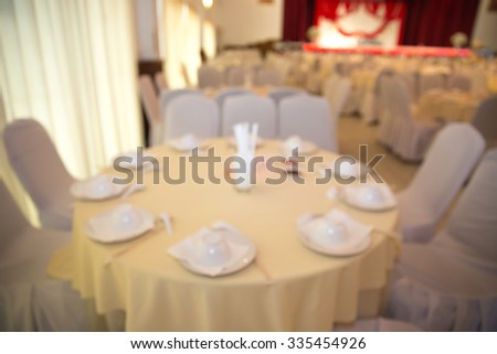 Blurred gorgeous wedding chair and table setting for fine dining.