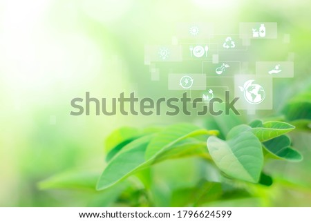 Blurred greenery background with copy space, Sustainable energy logo and technology icon. Agriculture and environmental concept. Ecology reuse and data analysis with internet of thing IOT Stockfoto ©