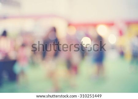 blurred group of people walking in shopping mall, pastel tone