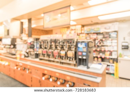 Blurred image a modern convenience store gas station in Arkansas, USA. Variety items on display such as impulse snacks, energy drinks, coffee, hot food, tobacco, cigarettes, clothes, lottery tickets