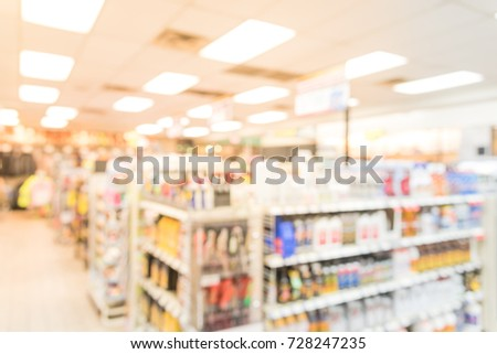 Blurred image a modern convenience store gas station in Arkansas, USA. Variety items on display such as impulse snacks, energy drinks, coffee, hot food, tobacco, cigarettes, clothes, lottery tickets #728247235