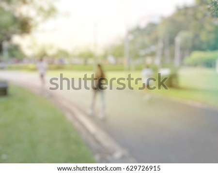 Blurred image background of summer activities with energetic people jogging, walking, running at green city park with bokeh light. Healthy lifestyle concept. #629726915