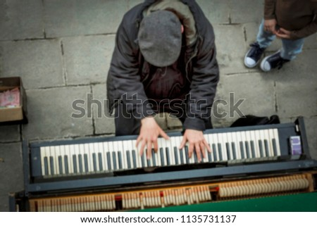 Photo of Blurred image, blur. motion blur. Street musician, top view. Concept: creativity, search for truth, a free artist