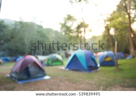 Blurred image Camping and tent under the pine forest in sunset. #539839495
