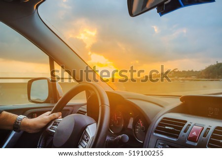 blurred image. driving car with sunset light / Vintage filter. #519100255